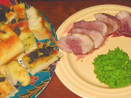 Roasted Pork Loin with red wine sauce, homemade focaccia and pea puree